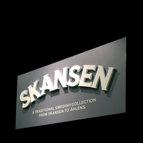 Frigolitskylt med text logo